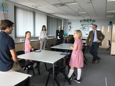Rugby MP Mark Pawsey observes a socially distanced lesson by Mr Payne at Rugby Free Primary.jpeg